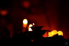 Silhouettes and Bokehs (Sudhamshu) Tags: orange india lamp silhouette festival fire poetry haiku bokeh decoration chennai 50mmf14 diya octagons phoetry vishukani