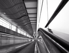 Long Way from the Gate to the Baggage Claim - Hamburg Airport, Germany (Batikart ... handicapped ... sorry for no comments) Tags: travel light vacation people urban bw white abstract black reflection building window architecture canon germany way square point geotagged deutschland licht vanishingpoint blackwhite spring airport gate holidays europa europe pattern floor pov geometry path fenster linie urlaub hamburg perspective haus row line april architektur sw flughafen vanishing weiss spiegelung gebude muster schwarz vacanze perspektive frhling endless hansestadt mensch g11 frhjahr 2011 endlos reihe 100faves 50faves fluchtpunkt 200faves rollband viewonblack airporthamburg batikart manconveyor bestcapturesaoi canonpowershotg11 elitegalleryaoi
