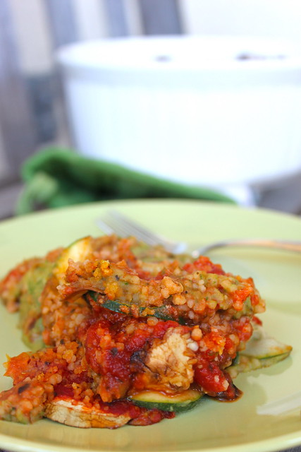 Layered Cous Cous Eggplant and Zucchini Casserole on green plate