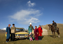 Family In Front Of Their Yurt And Car in Song Kol Lake, Kyrgyzstan (Eric Lafforgue) Tags: family people horse baby male men car horizontal female clouds standing person togetherness women asia exterior guitar fulllength bluesky tent riding hut together pasture yurt housing six centralasia kyrgyzstan humanbeing nomads saddle traditionaldress horseriding colorphoto bridle musicinstrument headgear kyrgyzrepublic lookingatcamera traditionalclothes 9828 sixpeople traditionalhat nomadiclifestyle groupofsix traditionalheadgear sixpersons songkollakearea jamanechkijailoo