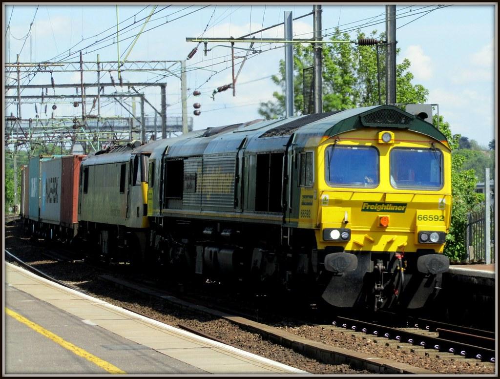 Class 66, 66592 'Johnson Stevens Agencies' and Class 90, 90047