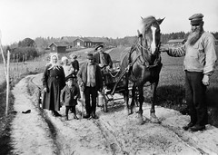 People in Kårsta, Uppland, Sweden (Swedish National Heritage Board) Tags: horse fence children beard wagon women tracks police farms ruts torp riksantikvarieämbetet theswedishnationalheritageboard