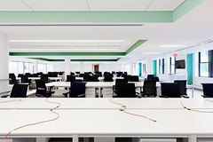Flat Iron Startup Office (Paintzen) Tags: modern office startup nyc new york desks chairs electric cord orange green ceiling lights white walls windows exit sign tv work cubicle employees staff flatiron