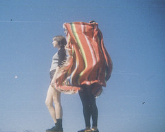 """She would say to me, you care..."" (H o l l y.) Tags: lomography 110mm film analog tiny kodak instamatic girls blanket blue sky summer retro indie vintage portrait fashion"