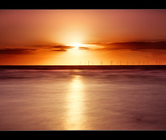 Atomic sunset II, Crosby. Explored (Ianmoran1970) Tags: sunset red sea orange cloud sun beach water power wind explosion wave explore atomic windfarm crosby explored ianmoran ianmoran1970