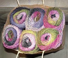 Variegated wool knitting yarn by Noro of Japan, in shades of olive, pink, purple and charcoal