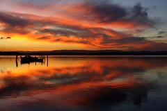 Fire Water (pominoz) Tags: sunset lake reflection swansea clouds boats nsw lakemacquarie thechallengefactory favouritecapture