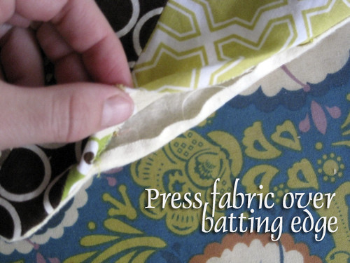 # 2 Press fabric over batting edge