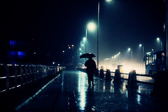 The Rain Man! (VinothChandar) Tags: summer india man hot beach rain weather night marina umbrella dark walking cool walk madras surreal atmosphere heat temperature chennai climate tamilnadu