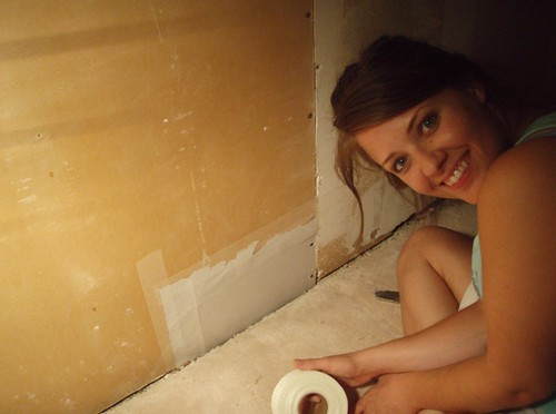 Karen fixing the wall
