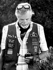 Portrait of Rob (sharon'soutlook) Tags: portriat man male blackandwhite bw patches pins sunglasses candid