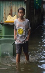 wading through the water (the foreign photographer - ) Tags: sep252916sony girl child wading water khlong thanon portraits bangkhen bangkok thailand nikon d3200