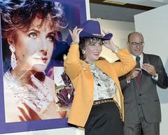 [Elizabeth Taylor with purple cowboy hat at Neiman Marcus store, Dallas] (SMU Central University Libraries) Tags: dallas texas neimanmarcus elizabethtaylor liztaylor