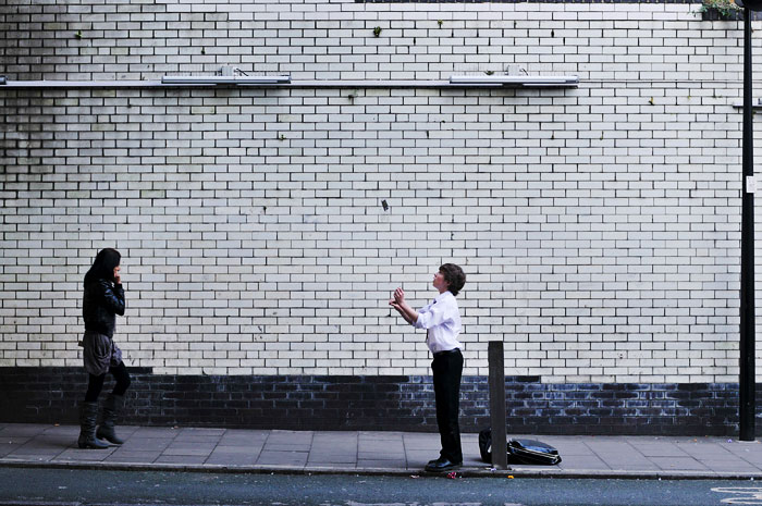 Boy tossing his phone for no apparent reason