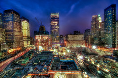 World Trade Center, New York City (mudpig) Tags: nyc newyorkcity longexposure cloud ny newyork building skyline night geotagged construction downtown cityscape nocturnal crane worldtradecenter 4 7 wtc gothamist bluehour goldman groundzero hdr sachs woolworthbuilding lighttrail millenniumhotel 7worldtradecenter freedomtower mudpig traffictrail 1worldtradecenter stevekelley worldtradehotel