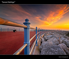 """Sunset Railings"" (awhyu) Tags: sunset red sea england sky cloud seascape west yellow carpet bay coast skies glow north lancashire rails railings morecambe"