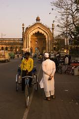 Public Transport in Lucknow (Shubh M Singh) Tags: light portrait india yellow architecture nikon gate alone arch dusk walk minaret muslim courtyard istanbul mosque dome onion nikkor lucknow islamic rumi constantinople roomi imambara uttarpradesh oudh d40 darwaza asafi imambada awadh
