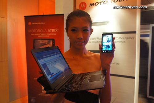 Model with Motorola Atrix docked on Motorola Lapdock.