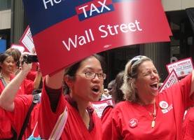 Nurses march on Wall Street