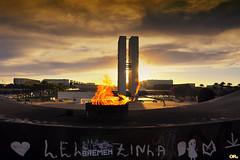 Flaming sunset (Otaclio Rodrigues) Tags: braslia capital distritofederal federaldistrict congressonacional nationalcongress prdosol sunset fogo fire monument monumento nuvens clouds pira pyre eternalflame chamaeterna memorial tancredoneves arquitetura architecture oscarniemeyer panteonacional nationalpantheon topf25