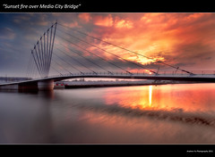 Sunset Fire over Media Bridge (awhyu) Tags: city bridge sunset water clouds fire march media long exposure bbc salford quays