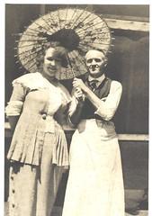 Sharing a Parasol! (cheryldecarteret) Tags: vintage tie scan apron parasol