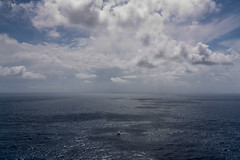 Sailing solo (Zalacain) Tags: ocean blue sea sky white water clouds boat spain sailing view cloudy space calm ibiza single lonely mediterraneansea determination inmensity gettyimagesspainq1 gettyimagesiberiaq2