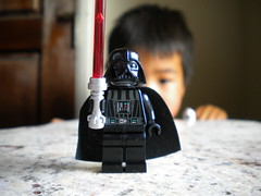 Biding his time with the Sith Lord (Kyle Strickland) Tags: light boy black star dof lego perspective lord darth legos saber granite wars vader sith cliche hcs