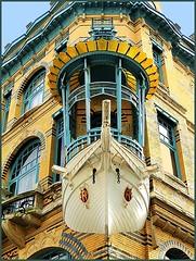 Art Nouveau houses in Antwerp 2 (jackfre2) Tags: blue house building glass yellow boat weird belgium balcony artnouveau antwerp mast loggia mygearandme schilderstraatplaatsnijderstraat