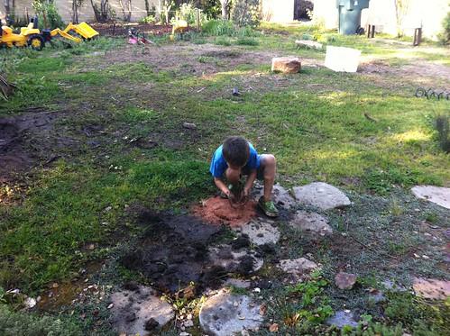 Ezra makes Finn a mud pie (with sprinkles)