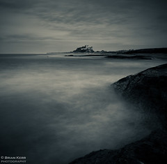 Bamburgh Castle (.Brian Kerr Photography.) Tags: sky seascape castle canon landscape mono coast blackwhite big sand rocks dunes northumberland coastal lee coastline northeast bamburgh stopper eos5dmkii briankerrphotography