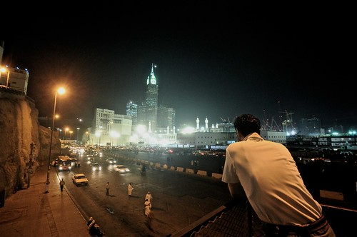 A man and the royal clock tower, Burj AlBait. - Ghazzah, Makkah.
