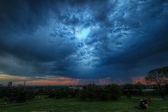 Sunset Thunderstorm over London (TheFella) Tags: park uk greatbritain blue trees sunset red england people storm green slr london wet rain weather digital photoshop canon eos photo high europe cityscape dynamic unitedkingdom camden hill capital landmarks londoneye landmark photograph processing gb thunderstorm bttower dslr primrosehill range thunder hdr highdynamicrange pouring downpour soaked primrose swisscottage postprocessing 500d photomatix