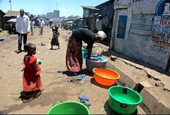 (Livia Lazar) Tags: woman kid kenya washing mathareslum