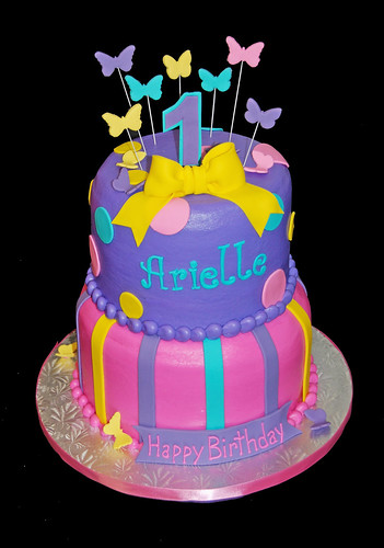 2 tier purple turquoise yellow and pink cake for a 1st birthday Abby Cadabby celebration