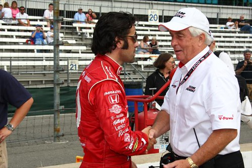 Dario shakes the hand of Roger Penske