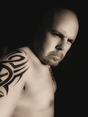 Tattoo in Sepia (CWhatPhotos) Tags: olympus epl1 elp1 four thirds digital camera 1442mm view photo photos pics picture pictures pic image images foto fotos that have with which contain sigma monochrome self portrait black white me cwhatphotos tattoo tattoos tattoed inked tribal tattooed ink body art upper arm shoulder arms chest sepia tone toning flickr