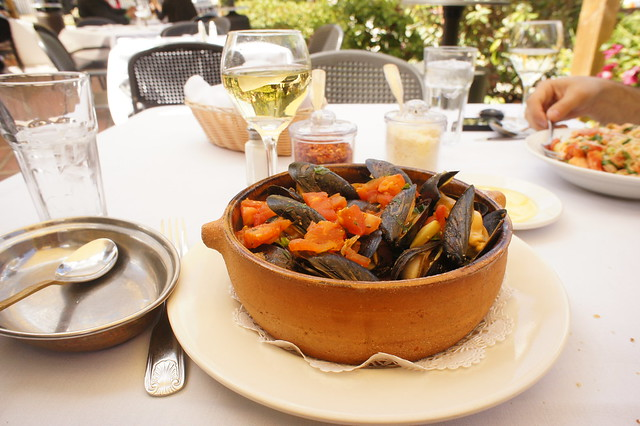 Mussels in a saffron broth on straw pasta