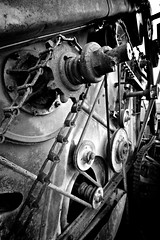 Gears Pulleys Chains and Belts (Dan Warkentin) Tags: bw chain combine gears