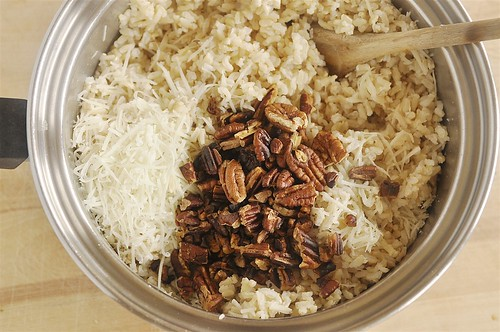 Brown RIce Parmesan cheese and toasted pecans in a pan
