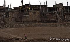 The old Upper Pisang (Meir Naamat) Tags: nepal house women village himalaya authentic pisang בית upperpisang אישה דרך עתיק אותנטי דגליתפילה aroundannapurnatrack