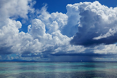 Storm over Mahe with Sailboat (rgarrigus) Tags: ocean sea vacation holiday seascape storm beach rain sailboat skyscape landscape island awesome indianocean relaxing thunderstorm seychelles tempest awe cloudscape impressive orage mahe ladigue greatphotographers baiesteanne garrigus robertgarrigus robertgarrigusphotography