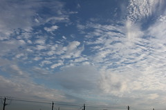 "there's always ""weather"" in texas (tejana) Tags: sky clouds patterns telephone wide wires poles"