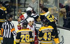 #54 Adam McQuaid challenges #29 Steve Ott (Odie M) Tags: nhl hockey icehockey boston tdgarden preseason teamsport sport ice fight roughing tough adammcquaid bostonbruins detroitredwings dominicmoore steveott lukeglendening brianferlin mattgrzelcyk