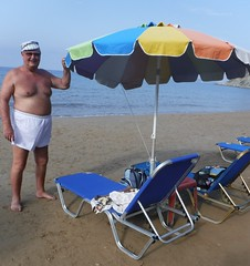Sunbeds and Brolly for 7 (pj's memories) Tags: corfu arillas seaside shorts mensshorts beach surridge rugbyshorts brolly sunlounger sunhat commando