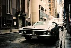 ready to rumble (ho_hokus) Tags: street newyorkcity ny newyork car rain truck vintage manhattan steam 35mmfilm grime chinonbellami dnpcenturia100 ny2011