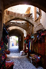 Vibrant shop on old path, Rhodes. (runintherain) Tags: castles buildings islands ancient europe medieval worldheritagesite greece rhodes rhodestown dodecanese rdos palaceofthegrandmaster grandmasterspalace canonxsi  canon450dxsi runintherain