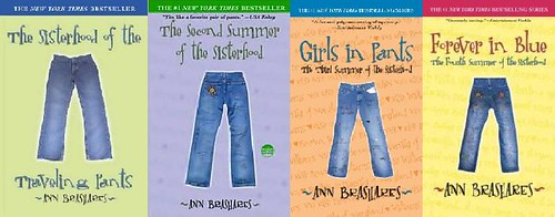 All four original covers of the YA series: The Sisterhood of the Traveling Pants, The Second Summer of the Sisterhood, Girls in Pants, and Forever in Blue. The covers are green, purple, orange, and yellow, respectively, and each has a simple picture of a pair of blue jeans on the front.