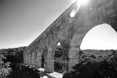Pont du Gard (France) (Rgine Conill) Tags: light sun white black bridge pont gard noir blanc aqueduc garrigue france romain