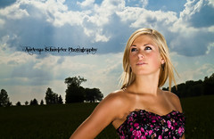 Blonde model in floral corset in a wheat field with storm clouds looming. (andreas_schneider) Tags: trees summer sky sun black floral grass sunshine clouds outside grid model wheat andreas greeneyes blonde corset softbox strom 580ex strobe schneider asphotography andreasschneider